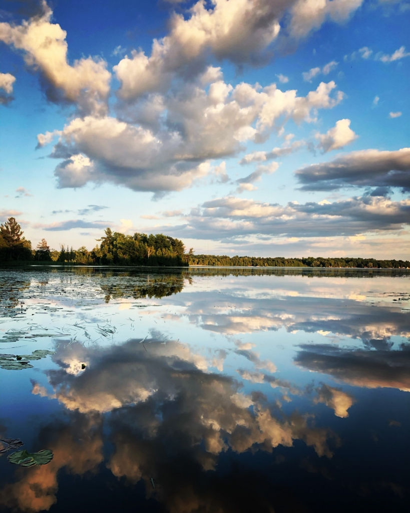 Landscape picture of lake and sky reflection